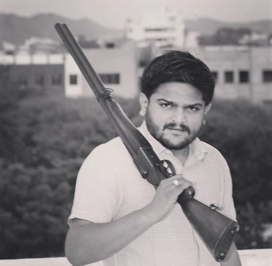Patel with rifle
