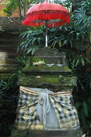 An empty throne of Sanghyang Widi Wasa, with poleng cloth and tedung umbrella, Ubud