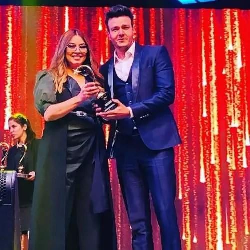 Anirudh Dave while taking award