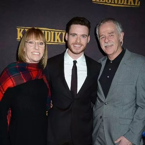 Richard Madden with parents