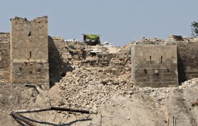 A view shows a destroyed section of the wall of Aleppo's ancient citadel as seen from a rebel-held area in Aleppo, Syria July 12, 2015. A section of the wall of the ancient citadel in Aleppo was destroyed by an explosion in a tunnel under the city, state media and activists reported on Sunday. The Syrian Observatory for Human Rights said the damage occurred when government forces blew up a tunnel dug by insurgents under the city, while the state news agency said the tunnel was blown up by rebels. REUTERS/Abdalrhman Ismail