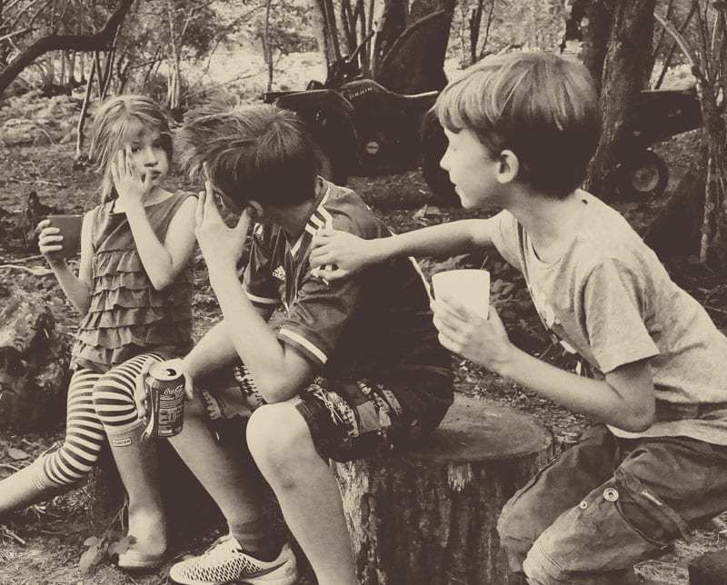 Kids by campfire