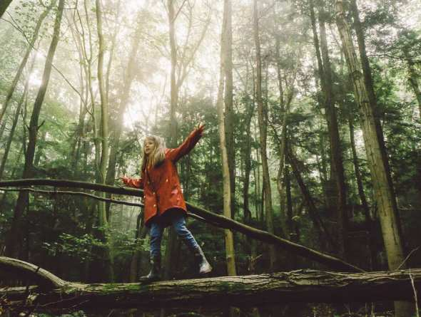 Luce walking on tree trunk