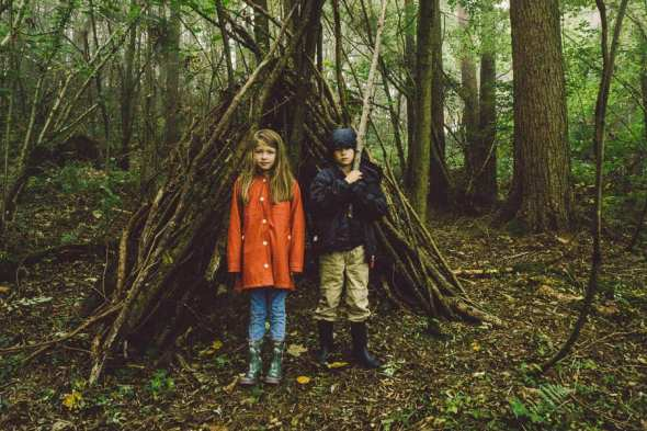 Theo and Luce with den in the woods