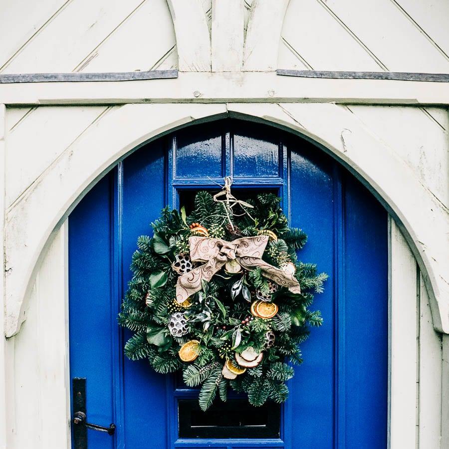 Christmas wreath on blue front door