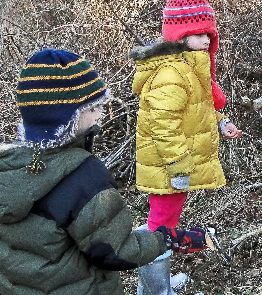Kids bird watching bird in the hand