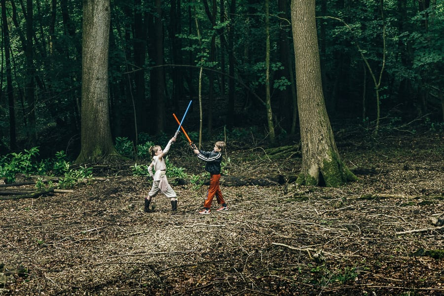 Lightsaber battle in woods kids clash