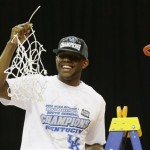 Kentucky's Darius Miller holds the net after cutting it down after an NCAA tournament South Regional finals college basketball game against Baylor Sunday, March 25, 2012, in Atlanta. Kentucky won 82-70. (AP Photo/David J. Phillip)