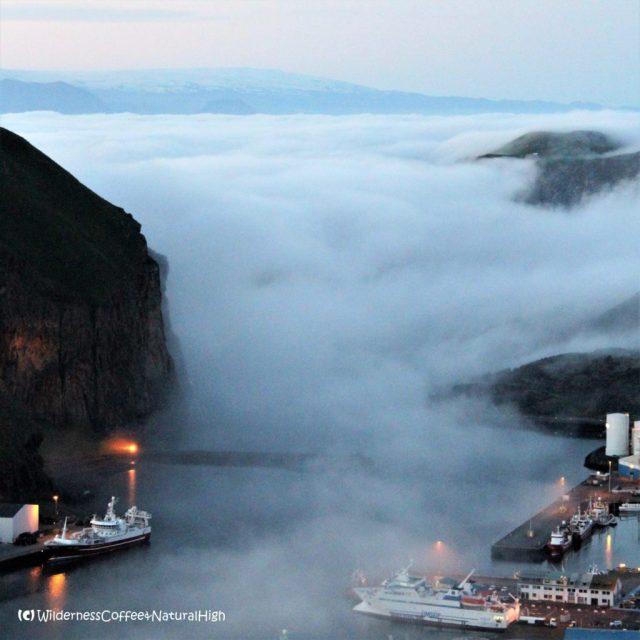 Fog waterfall gushing into Heimaey harbour, Vestmannaeyjar, Iceland