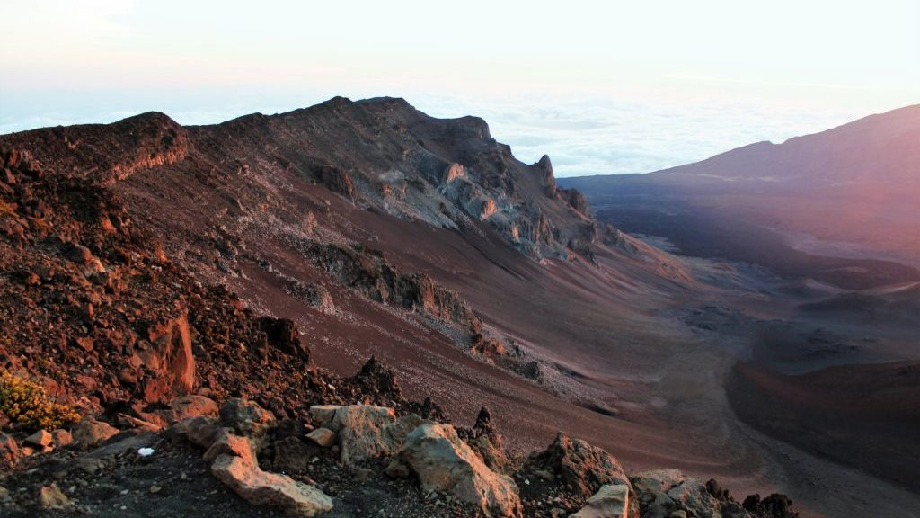 Sunrise into the Ko'olau Gap caldera on Mount Haleakala, Maui, Hawaii