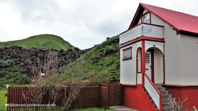 House on the edge of the lava flow, Heimaey, Vestmannaeyjar, Iceland