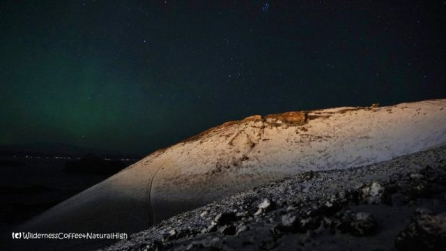 Eldfell volcano with snow and northern lights, Vestmannaeyjar, Iceland
