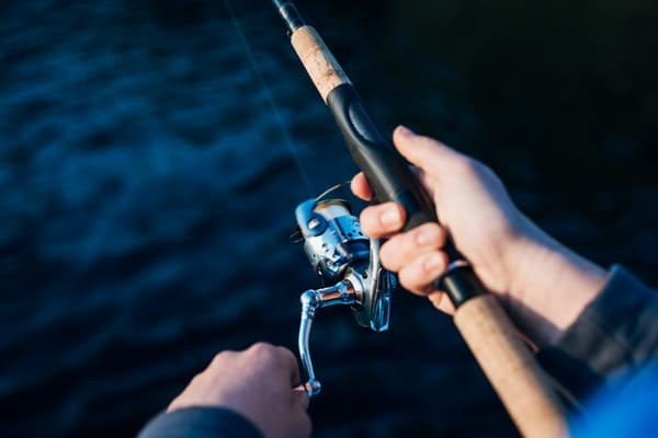 photo-of-person-holding-fishing-rod