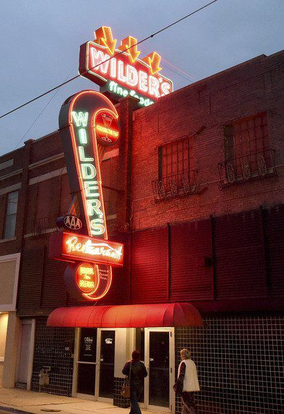 Restored Wilder's neon sign glows over Main Street again