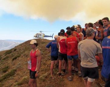 Australian football team evacuated ahead of advancing bushfire