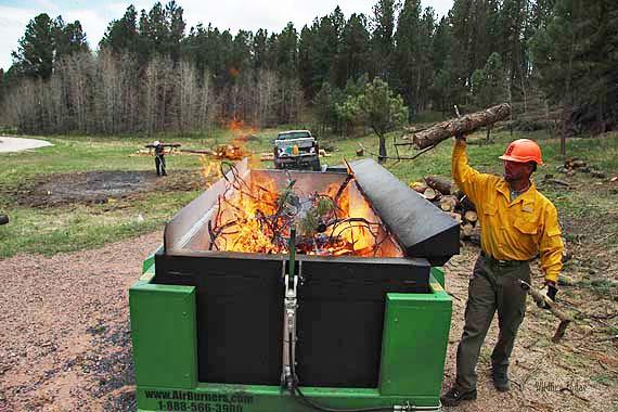 an air curtain to burn bug tree debris