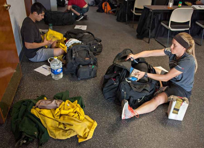 Jesus Lopez and Justine Bundy inventory their freshly issued equipment as the Mesa Hotshots began their critical training prior to the start of the season.