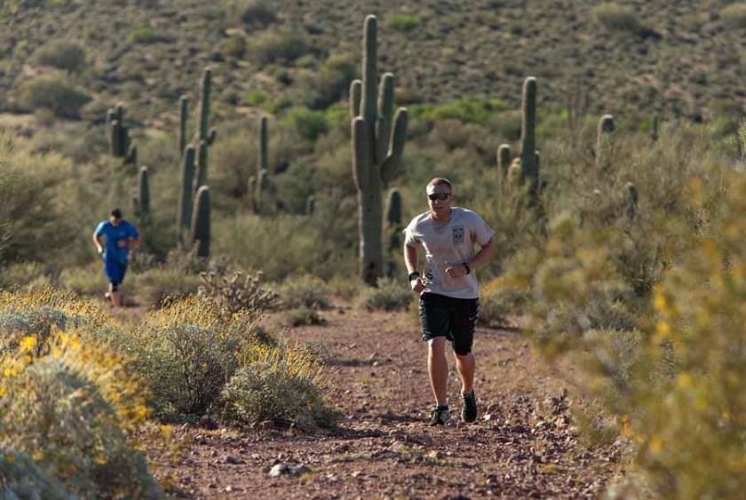 Ryan Conray leads James Robbins along a ridge line trail during the run portion of the Mesa Hotshots Desert Assesment.