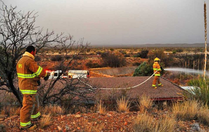 Park Service structural fire crew wets down structures near Panther Junction. NPS photo.