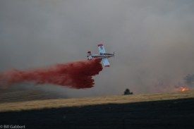 Air Tanker 855 drops on the Indian Canyon Fire at 8:27 p.m. MDT July 16, 2016
