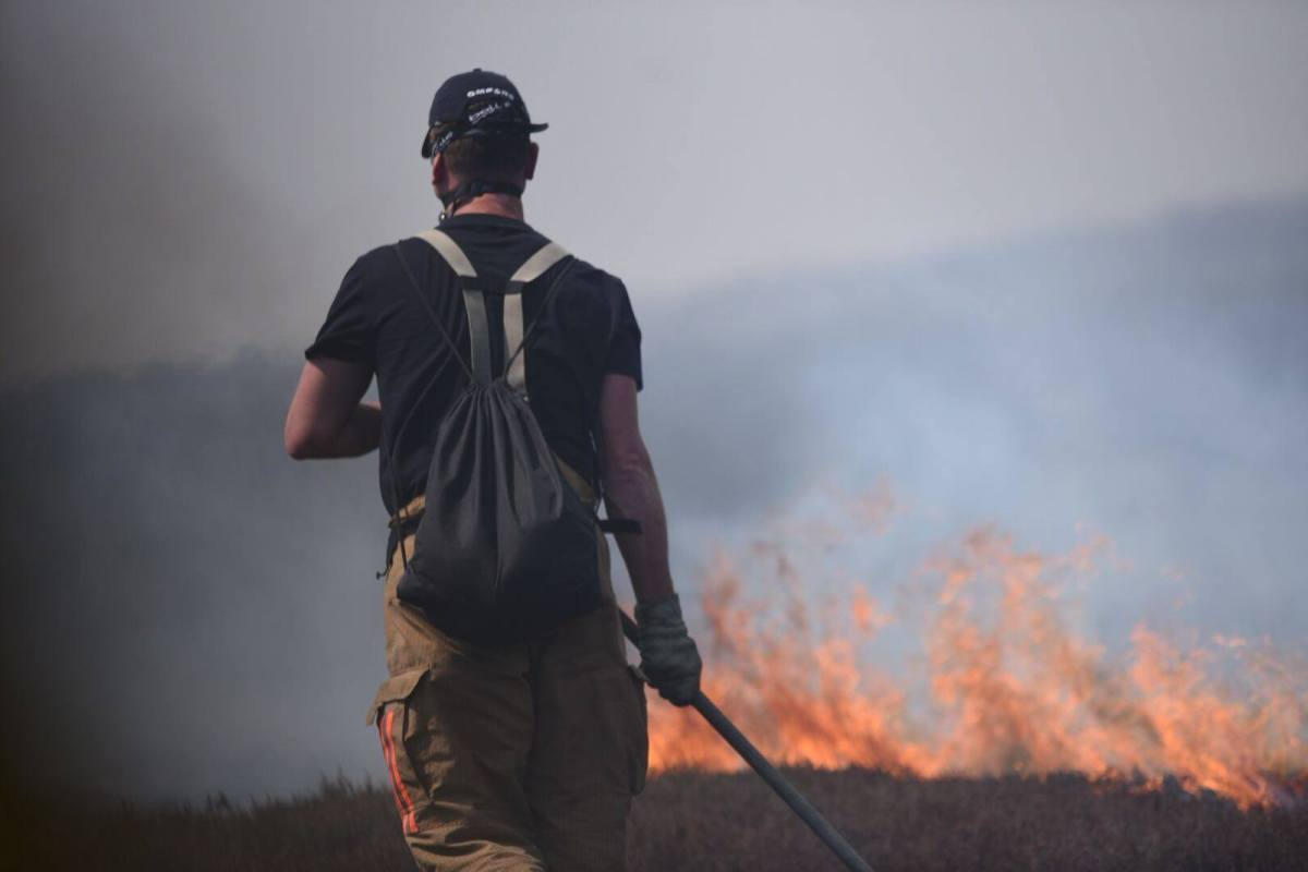 Saddleworth Moor fire in England contained; hot temperatures to linger