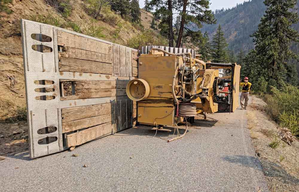 Rollover of a trailer loaded with a dozer on Cougar Creek Fire