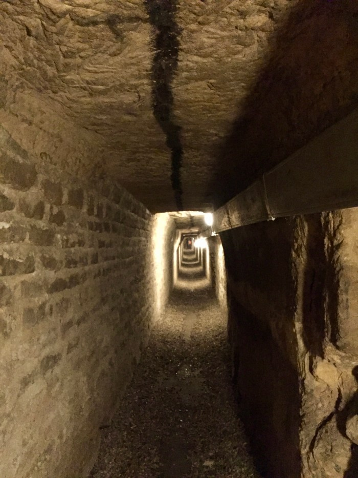 The ceiling is marked with centuries of candlelit treks into the catacombs
