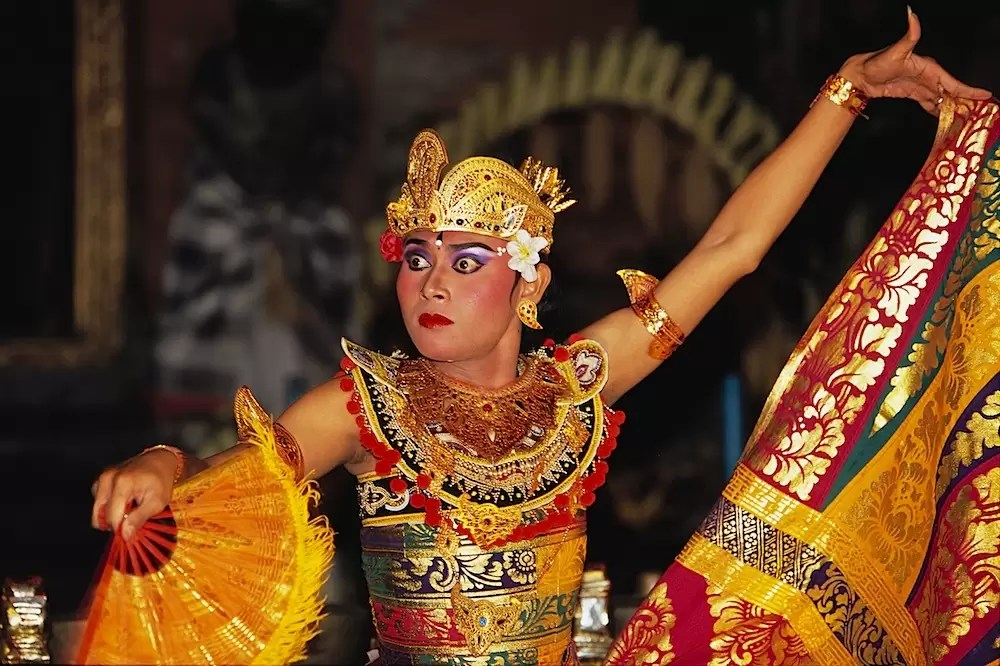 Legong dancer dancing in temple, Bali, Indonesia