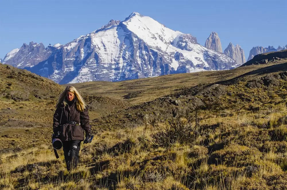 A photographer hiking in search of wild pumas in Torres del Paine