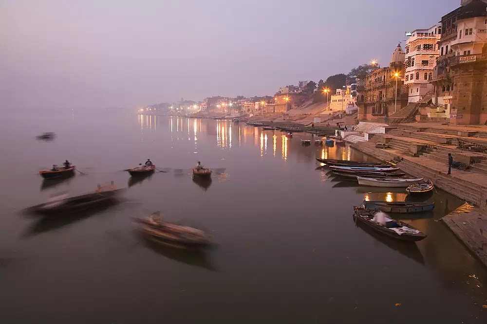 Boats on the Ganges River near the Ghats (stairs) at dawn