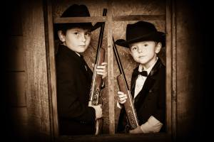 Young Cowboys in window at Wild Gals Old Time Photo in Pigeon Forge Tn