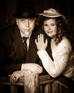 A couple posing for an old time photo.