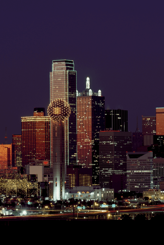 Where to eat, stay and play in Dallas. The Dallas skyline is twinkling under the night sky.