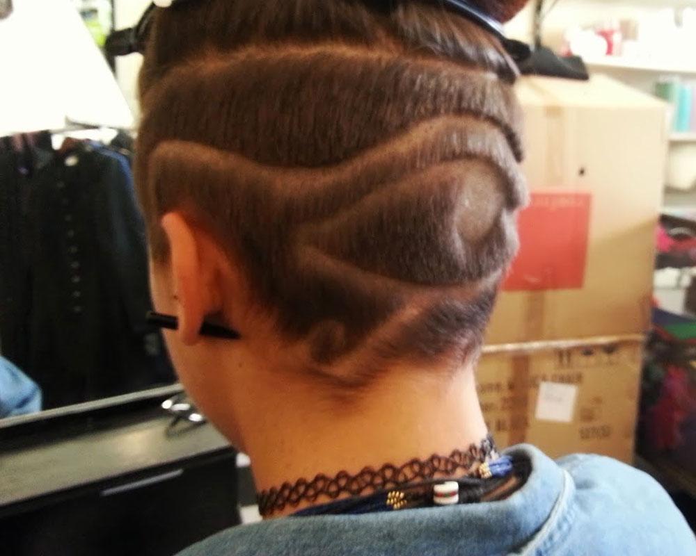 egytian eye swirls hair tattoo 3
