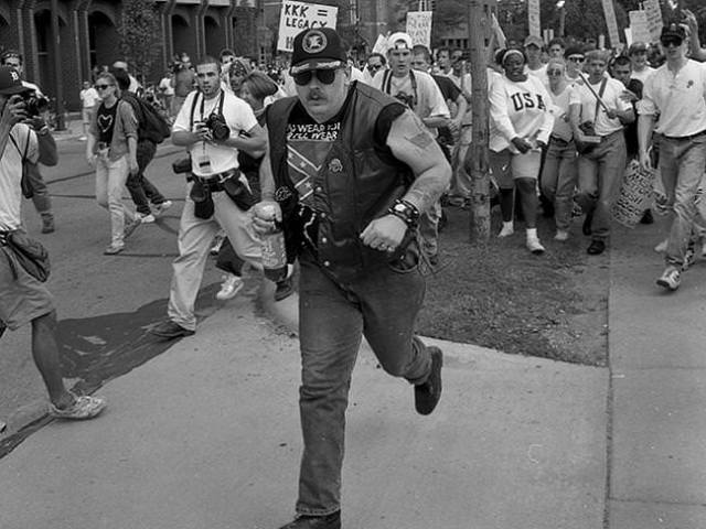 kkk supporter running from mob, ann arbor