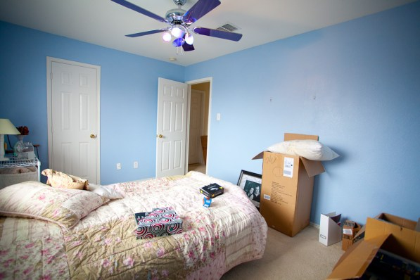 "Before: Bright blue walls and what Sarah calls a ""UFO"" ceiling fan"