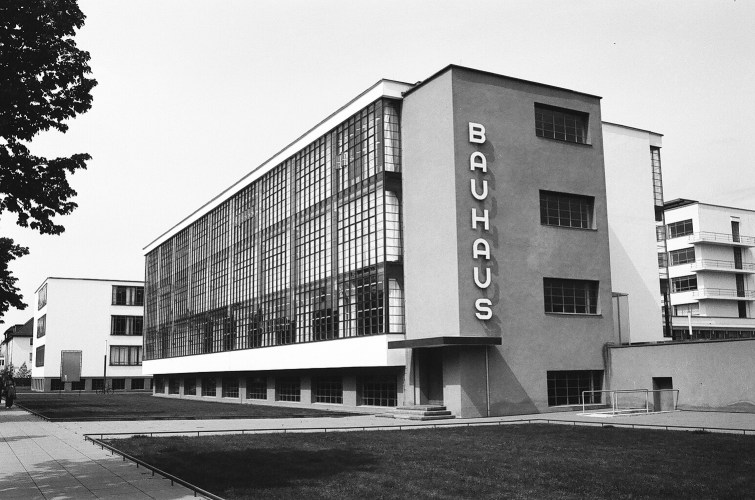 Modern building with glass exterior, example of Bauhaus architecture.