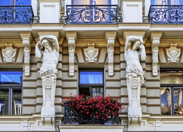 Art Nouveau style building face with ornate carved statues and intricate detail work