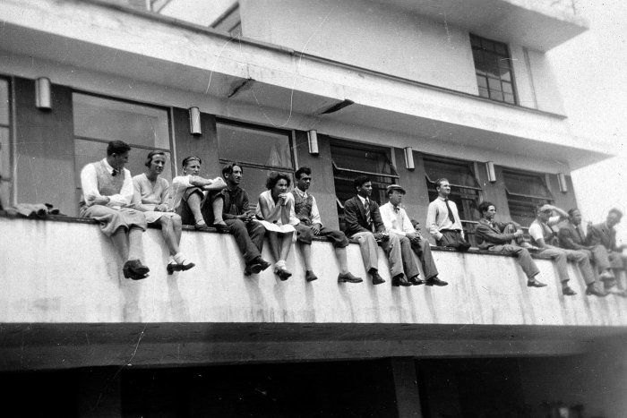 Students sit on a ledge at the Bauhaus in Dessau, 1931