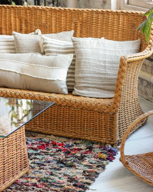 modern bohemian style decor with rattan furniture and jute rug