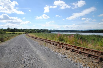 The Waterford Greenway, beside the River Suir, The Suir Valley Light Railway and Mount Congreve on the left.