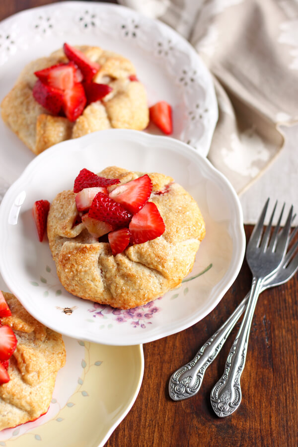 This recipe makes just 4 individual size Strawberry Galettes, perfect for two, for dessert one night and breakfast the next morning! | wildwildwhisk.com