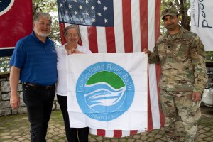 "Lt. Col. Sonny B. Avichal, U.S. Army Corps of Engineers Nashville District commander, presents the ""Clean Marina"" flag to John and Natasha Deane, owners of Wildwood Resort and Marina, during a dedication May 21, 2020 at the resort located at Cordell Hull Lake in Granville, Tennessee. The event recognized the marina's voluntary efforts to reduce water pollution and erosion in the Cumberland River watershed, and for promoting environmentally responsible marina and boating practices. (USACE photo by Lee Roberts)"