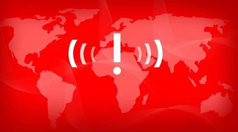 weißes Ausrufezeichen auf roter Weltkarte