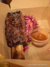 Rib served with slaw and sauce by 'Hot Box'