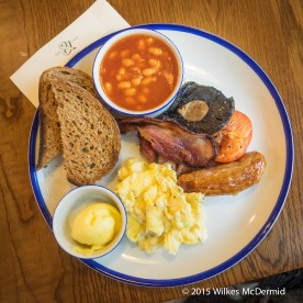 """The Fisherman's Breakfast (""""Streaky bacon, Cumberland Sausage, eggs, field mushrooms, grilled tomato, baked beans, French toast with a offer of your choice"""")"""