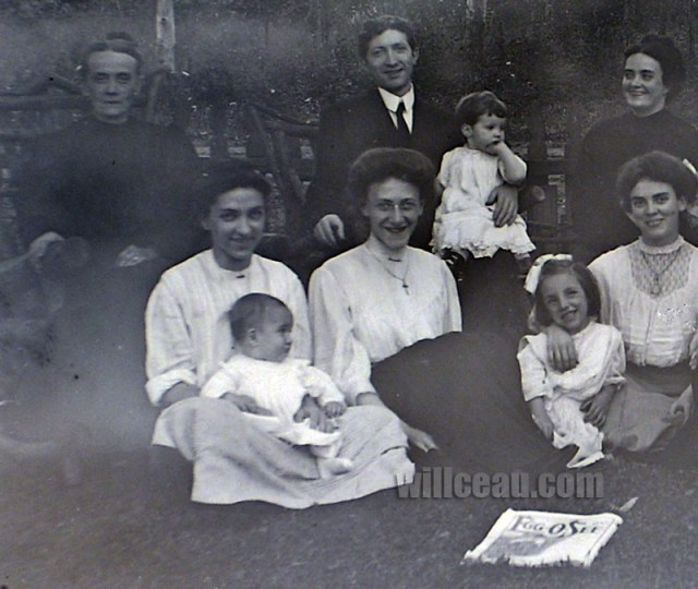 Ella and (probably) John, Jr are seated on the far left.