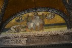 "This mosaic is above the Imperial door and shows Emperor Leo VI giving proskynesis (an act of respect) to Christ seated on the throne. Christ is blessing the Emperor and the greek words on the book held by Christ say ""Peace be with you. I am the Light of the World"" The two pictures are of Mary and the Angel Gabriel"