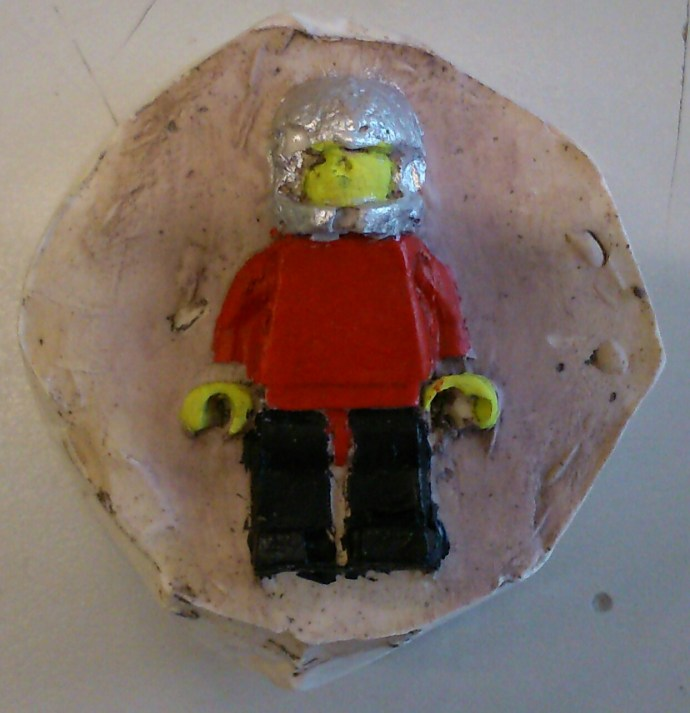 Lego man cast in plaster (painted)