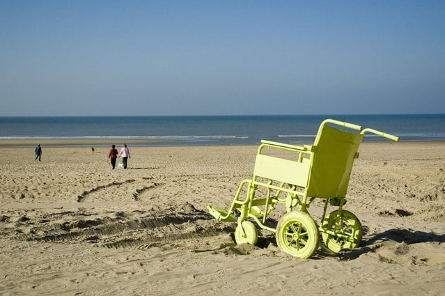 Image of aqua wheelchair next to the beach for swimming with disabilities.